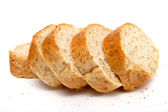 Cutted long loaf with bran — Stock Photo