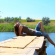 Lying on a pier — Stock Photo