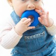 Child at jeans suit with toy — Stock Photo