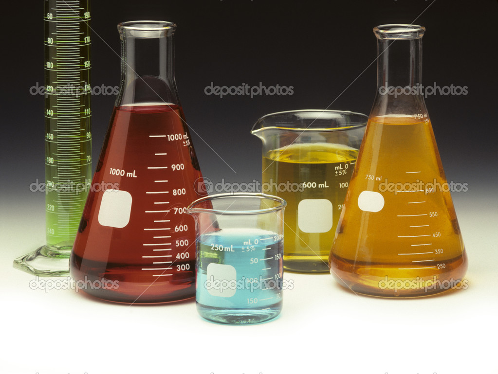 Scientific glassware filled with colored liquids on a graduated background — Stockfoto #1610546