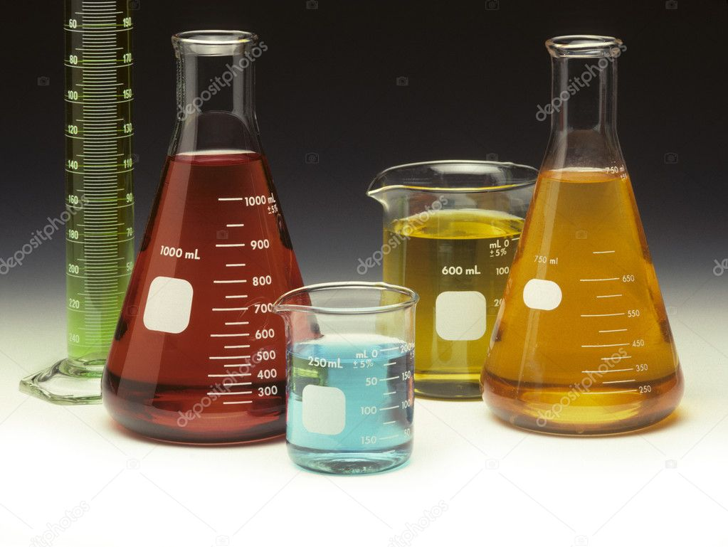Scientific glassware filled with colored liquids on a graduated background — Photo #1610546