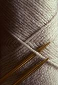Yard with knitting needles — Stock Photo