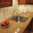 Steel sink in a remodeled kitchen - Stock Photo