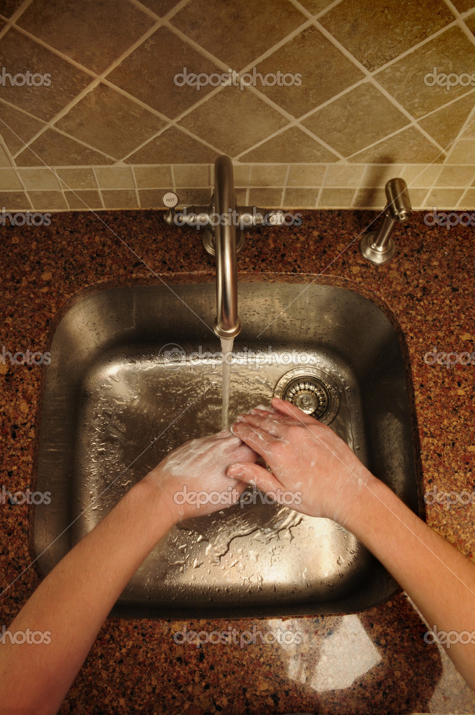 Overview of hand washing over a sink stock image