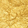 Crumpled gold foil textured background — Stock Photo #1746361