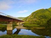 The railway bridge at a mountain slope — Stock Photo
