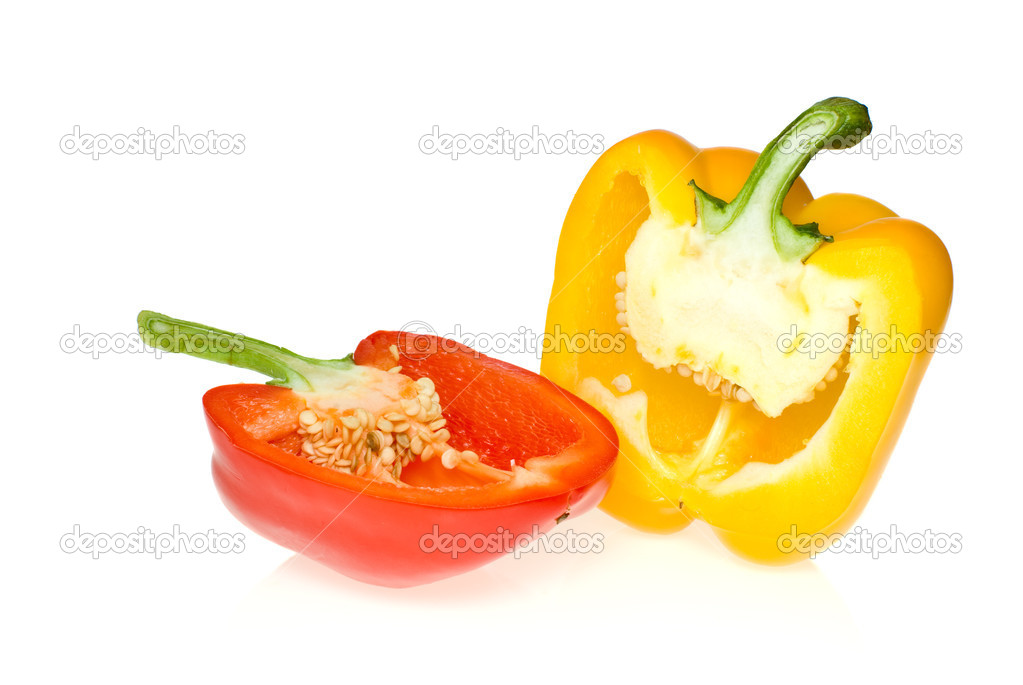 Half of red and yellow sweet peppers isolated on the white background — Stock Photo #1668212