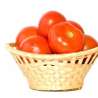 Wicker basket with tomatoes - Stock Photo