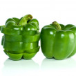 Whole green sweet pepper and few slices — Stock Photo