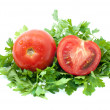Tomatoes and half with some parsley — Stock Photo #1683572