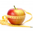 Yellow-red apple and measurement tape — Stock Photo