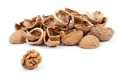Some nutshells and walnut kernel — Stock Photo