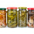 Glass jars with marinated vegetables — Stock Photo #1690368