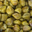 Stock Photo: Marinated capers background