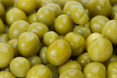 Background of conserved green peas — Stock Photo