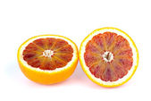 Blood (red-pulp) orange sliced on halves — Stock Photo