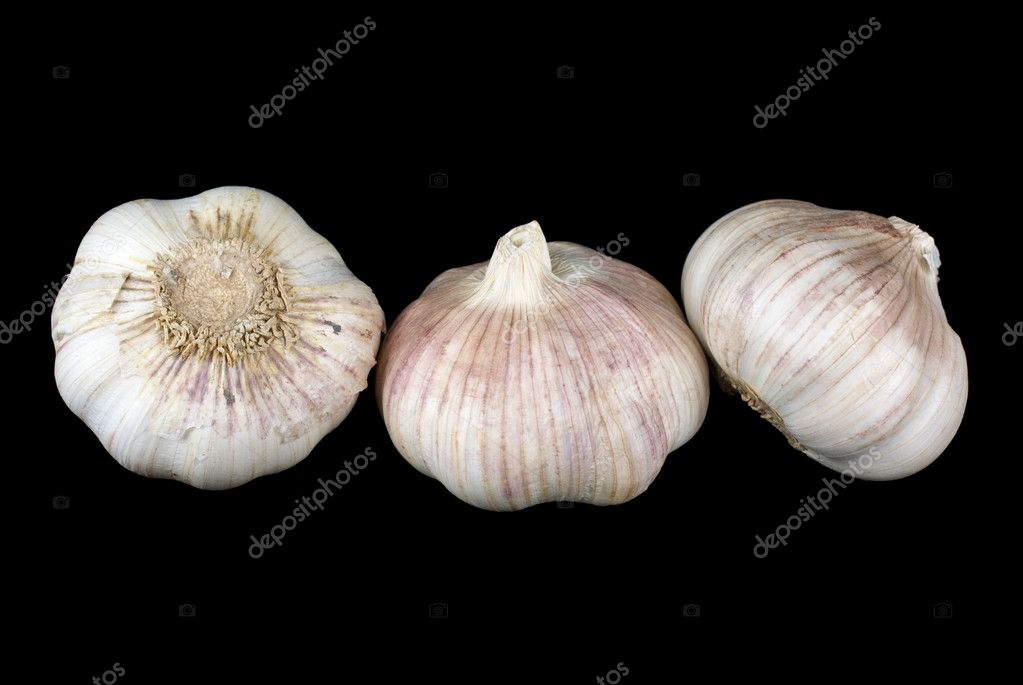 Some garlic over the black background — Stock Photo #1935369