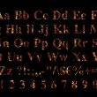 Alphabet stylized to charred embers — Stock Photo #1620781