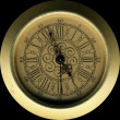 Isolated vintage brass clock front panel — Stock Photo #1621055
