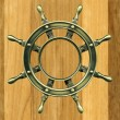 Bronze wheel on a wooden board - Lizenzfreies Foto