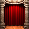 Royalty-Free Stock Photo: Red velvet curtains behind the stone