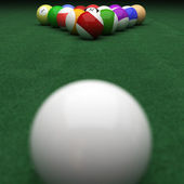 Targeting billiard balls on green — Stockfoto