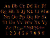 Alphabet stylized to charred embers — Stock Photo