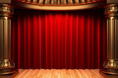 Red velvet curtains behind the gold — Stockfoto