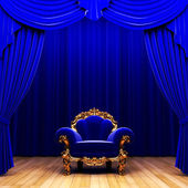 Blue velvet curtain and chair — Stock Photo