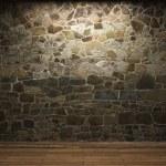 Illuminated stone wall — Stock Photo