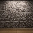Illuminated stone wall — Stock Photo #1739144