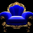 Classic golden chair in the dark — Stockfoto