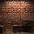 Illuminated brick wall and boxes — Stock Photo