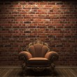 Royalty-Free Stock Photo: Illuminated brick wall and chair