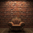 Illuminated brick wall and chair — Stock Photo #2566990