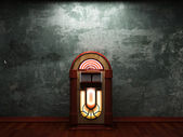 Old concrete wall and jukebox — Stock Photo