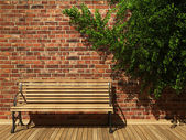Illuminated brick wall and bench — Stock Photo