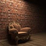 Illuminated brick wall and chair — Stock Photo