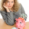 Woman with a piggybank — Stockfoto