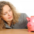 Woman with a piggy bank — Stok fotoğraf