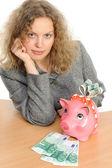 Woman with a piggybank — Stock Photo