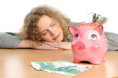 Woman with a piggybank — Stock Photo