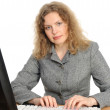 Woman smiling in front of her computer — Stock Photo