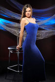 The beautiful woman in a dark blue — Stock Photo