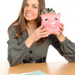 Royalty-Free Stock Photo: Business woman with a piggy bank