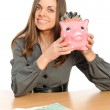 Business woman with a piggy bank — Stock Photo #2245443