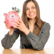 Business woman with a piggy bank — Stock Photo