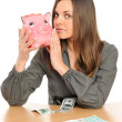 Business woman with a piggy bank — Stock Photo #2245480