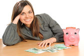Business woman with a piggy bank — Stockfoto