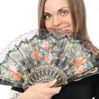 Stock Photo: Beautiful young woman with fan